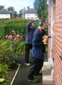 Julie and Helen, two of the Prevention of Falls joiners, fitting some grab rails to a front door