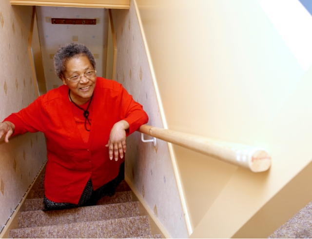 Service user who has a mopstick rail fitted to her staircase
