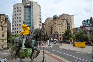 The Black Prince in City Square wearing his yellow jumper knitted by the ladies from Holt Park Active