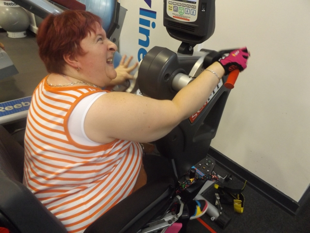 Gaynor doing her sponsored arm cycle at Holt Park Active gym