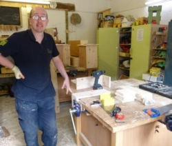Photograph of Russell, one of the Woodwork Project volunteers, in the woodwork room.