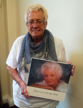 Pat with a memory book of her mum Dorethy