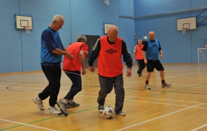 Joining a local sport such as Walking Football can help you stay active.