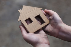homeless-boy-holding-cardboard-house-dirty-hand-53499972
